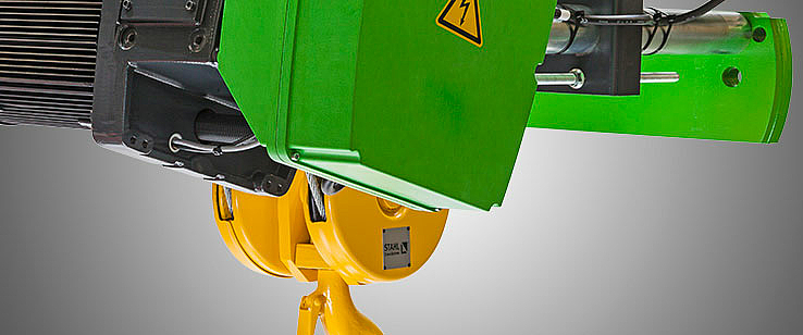 Parts of an SH wire rope hoist painted green, black and yellow