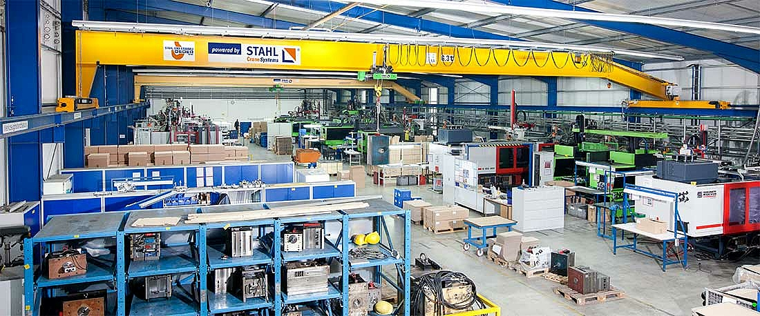 Single girder overhead travelling crane with SH wire rope hoist in a low warehouse in Germany