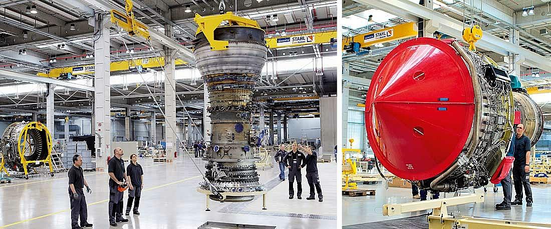 Um diferencial de cabo SHF levanta um motor numa empresa de reparação de motores.