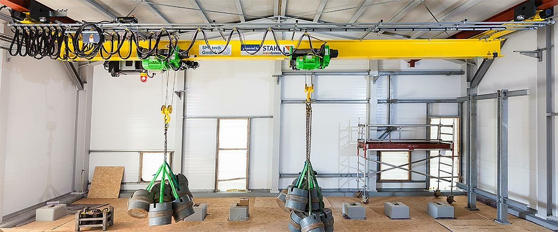 Single girder overhead travelling crane with two explosion-proof SH 40 Ex wire rope hoists in tandem mode