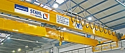 Double girder overhead travelling crane with top-flange trolley and AS 7 wire rope hoist