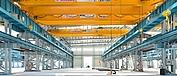 Pont roulant posé bipoutre dans un bâtiment de production