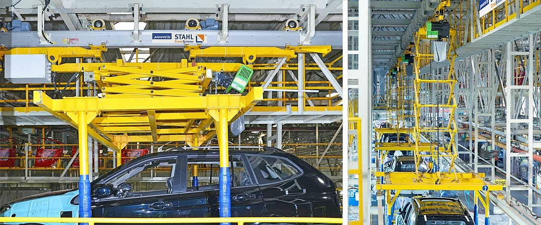An STD dual chain hoist lifts a car body in a Chinese car production plant.