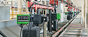 Use of multiple chain hoists of the type ST 50 in an automotive production line.