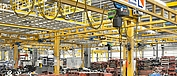 Industrial production shop equipped with ST chain hoists from STAHL CraneSystems