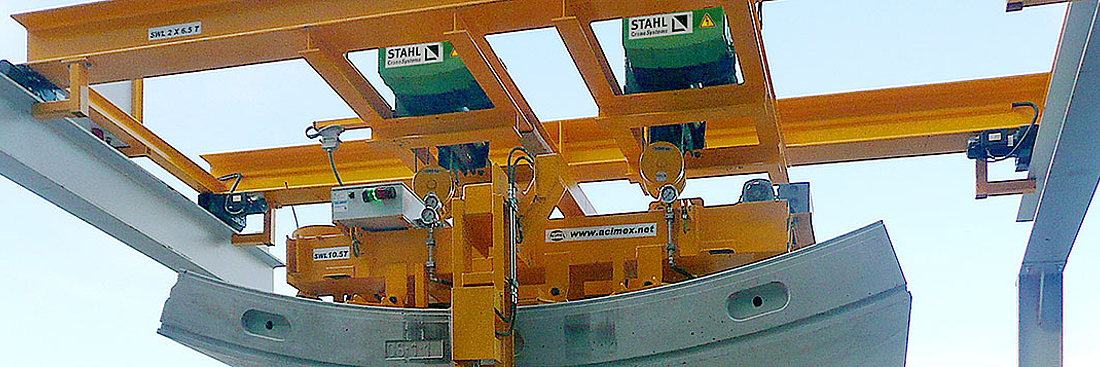 TAHL CraneSystems hoist are lifting heavy precast elements by way of air vacuums.