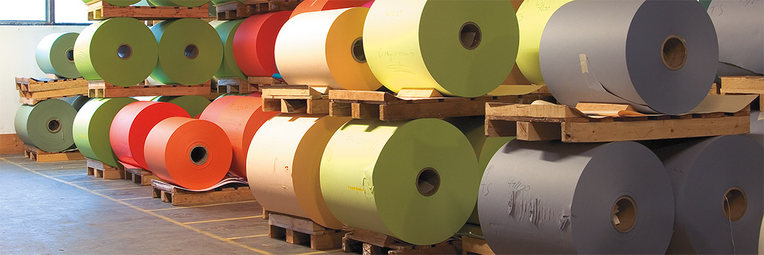 Coloured paper reels on pallets
