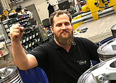 Employee at his workplace at STAHL CraneSystems in Künzelsau