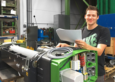 Dominik Langner at his workplace at STAHL CraneSystems in Künzelsau
