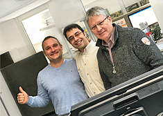 Group photo of three employees at their workplace at STAHL CraneSystems in Künzelsau