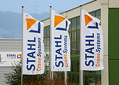 STAHL CraneSystems' flags waving in the wind in front of the company headquarters in Künzelsau, Germany