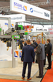 Visitors and staff at the STAHL CraneSystems stand at the LogiMAT 2019.