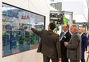 STAHL CraneSystems staff at the stand at LogiMAT 2019 using the interactive media installation.